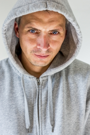 hooded shirt: portrait of a man in gray hooded shirt