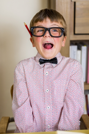 little nerdy boy with geeky goggles, making facial expressions  Stock Photo