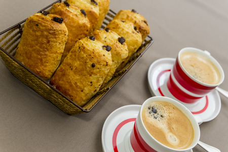 fresh baked chocolate croissants with two coffees photo