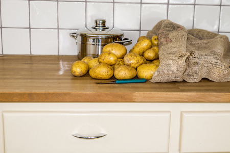 gunny bag: old fashion kitchen with potatos in gunny bag and coocking pot