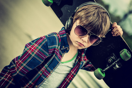 cool looking skater boy, with sunglasses and headphone vintage effect added