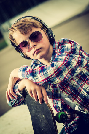 skater boy: cool looking skater boy, with sunglasses and headphone vintage effect added