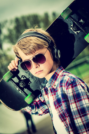 skater boy: cool looking skater boy, with sunglasses and headphone