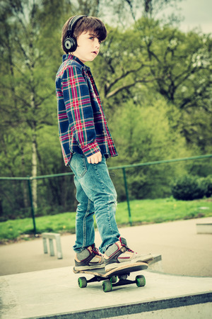 skater boy: cool looking skater boy with headphone, vintage effect added