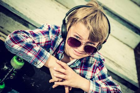 skater boy: close up portrait of a cool skater boy, vintage effect added Stock Photo