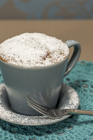 cup cakes: cupcake made in a coffee cup, with powdered sugar Stock Photo