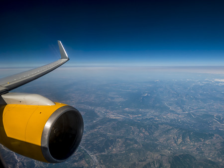 airplane engine: airplane engine and wing high up in the sky Stock Photo