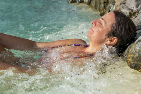 beautiful middle aged woman relaxing in a whirlpool