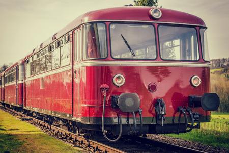 beautiful vintage diesel railbus on railroad with vintage filter 版權商用圖片