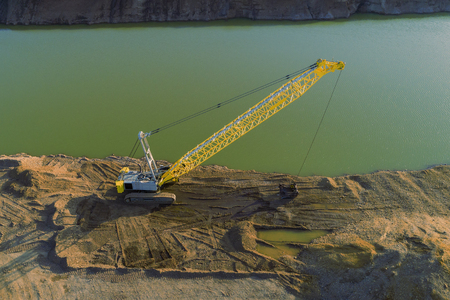 drone shot of a dredging crane near the water Stock Photo