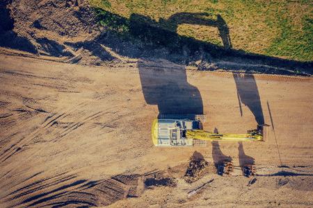 drone shot of a excavator at sunset 版權商用圖片