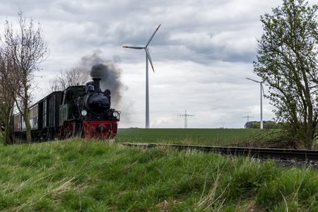 old steam train in a modern environment