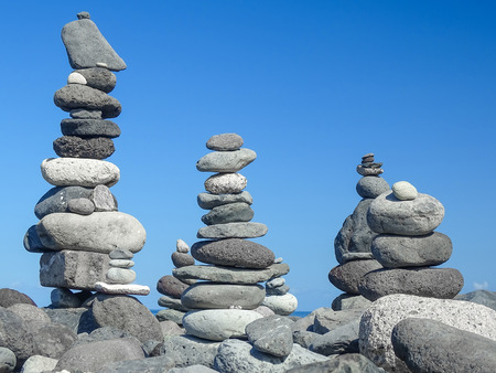 towers of gray stones in balance in a blue sky background Stock Photo