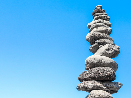 a tower of gray stones in balance