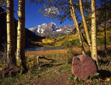 The Maroon Bells & Maroon Lake in the White River National Forest of Colorado, photographed during the autumn season. photo