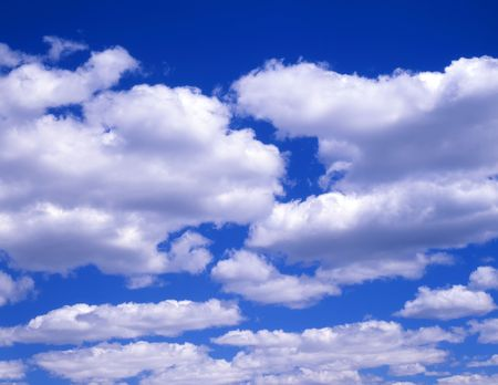White clouds in a blue sky. Stock Photo