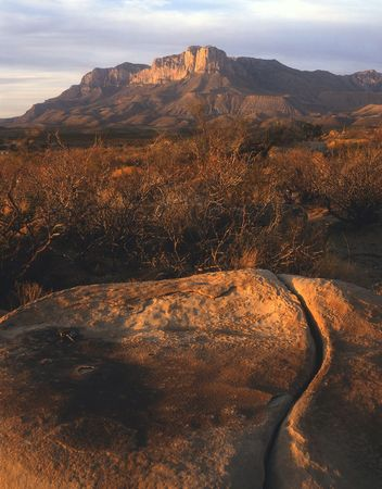 A cracked rock and the Guadalupe Mountains in west Texas.