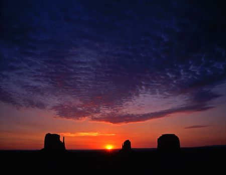 Sunrise and the Mitten Buttes in Monument Valley Navajo Tribal Park, Arizona. Stock Photo - 717841
