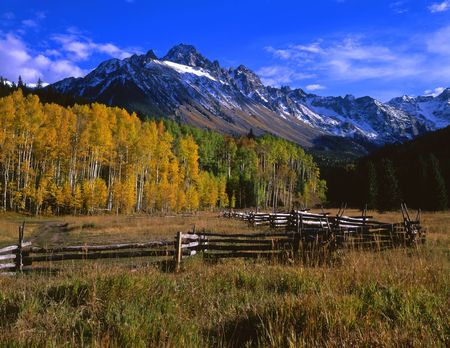 A corral and Mt, Sneffels in the Uncompahgre National Forest of Colorado, photographed during the autumn season.