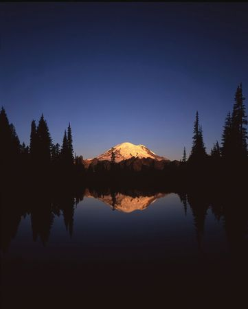 Mt. Rainier and Tipso Lake in Mt. Rainier National Park located in Washington State. Stock Photo