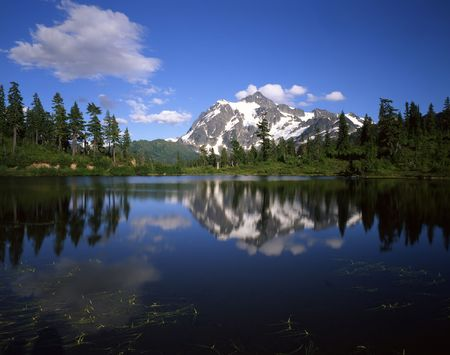 Mt. Shuksan ferlecting in Picture Lake in the Mt. Baker Wilderness, Washington State. Stock Photo