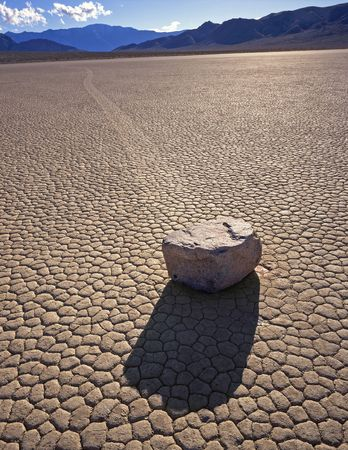 death valley: A rock and its trail on the Racetrack Playa in Death Valley National Park, California. Stock Photo