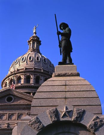 A statue and the Texas State Capitol Dome in Austin, Texas.