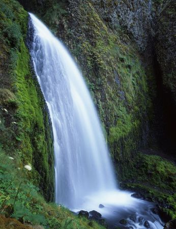 A waterfall along the Columbia River Gorge Senic Area in the Mount Hood National Forest of Oregon. Stock Photo