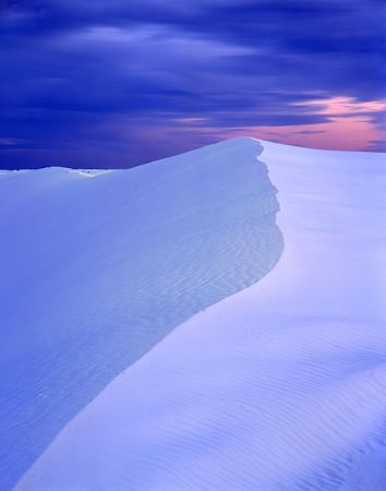 A sand dune in White Sands National Monument, New Mexico, photographed at sunset.