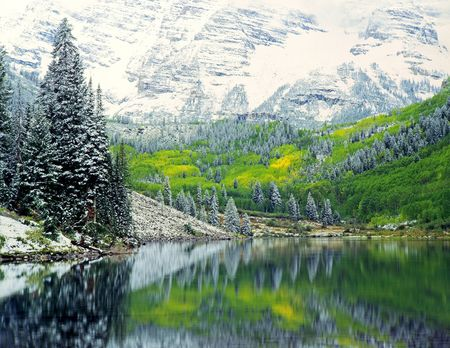 Snow in September, while the leaves are changing, in the White River National Forest of Colorado.