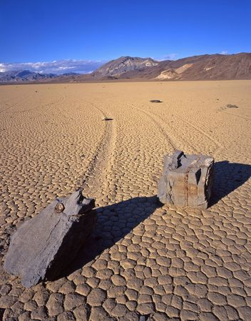 Two rocks and their trails on the Racetrack Playa in Death Valley National Park, California. Stock Photo - 760732