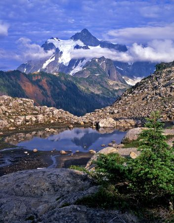 Mt. Shuksan reflecting in a pool of water in the Mount Baker Wilderness Area of Washington State. Stock Photo