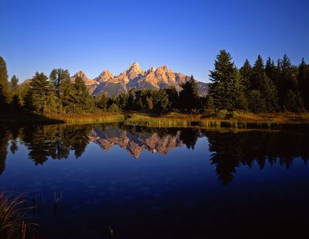 The Teton Range reflecting in the Snake River, at Schwabachers Landing, in Grand Teton National Park, Wyoming. Stock Photo - 777644