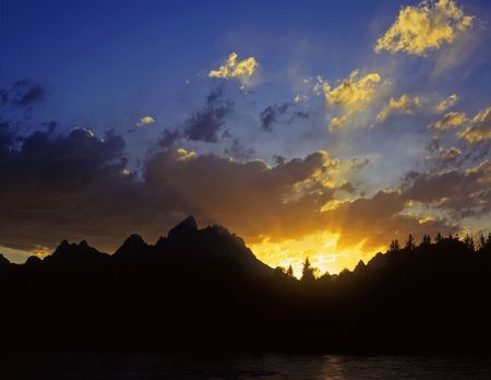 The Grand Teton Mountain Range, in Grand teton National Park Wyoming, silhouetted at sunset. Stock Photo