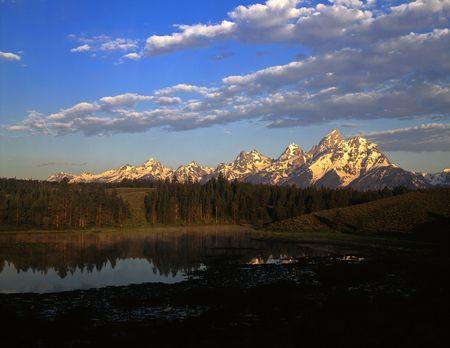 A pond and the Grand Teton Mountain Range in Grand Teton National Park, Wyoming. Stock Photo - 814091