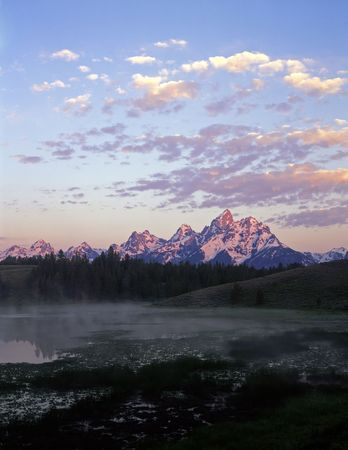 A pond and the Grand Teton Mountain Range in Grand Teton National Park, Wyoming. Stock Photo