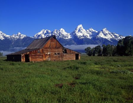 The Moulton Barn and the Teton Mountain Range in Grand Teton National Park, Wyoming.