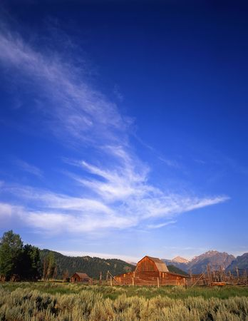 A barn, corral and part of the Teton Mountain Range in Grand Teton National Park, Wyoming.