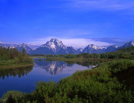 river banks: An Oxbow Bend of the Snake River, Mt. Moran and the Teton Mountain Range, located in Grand Teton National Park, Wyoming.