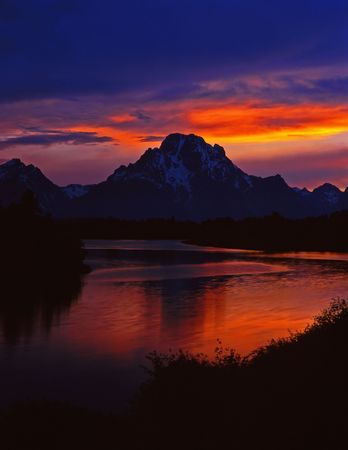 The Oxbow Bend of the Snake River and Mt. Moran, in Grand Teton National Park, Wyoming, photographed at sunset.