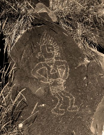 A petroglyph, of a Dancing Indian, in Petroglyph National Monument located in Albuquerque, New Mexico.