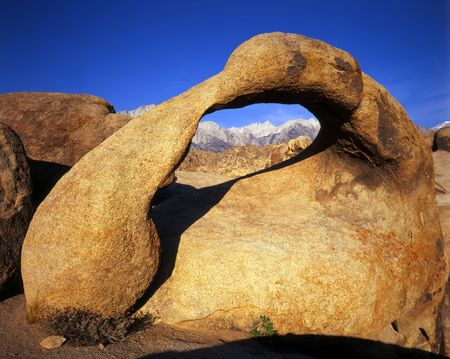 Mt. Whitney framed by Galen Arch, located in the Alabama Hills section of the Inyo National Forest, California. Stock Photo - 1195101