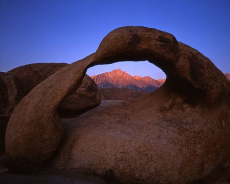 Lone Pine Peak as viewed through Galen Arch in the Alabama Hills section of the Inyo National Forest. Stock Photo