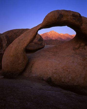 Lone Pine Peak viewed through Galen Arch located in the Alabama Hills section of the Inyo National Forest, California.