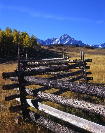 Mt. Sneffels and a log fence in the Uncompahgre National Forest, Colorado. Stock Photo - 2167357
