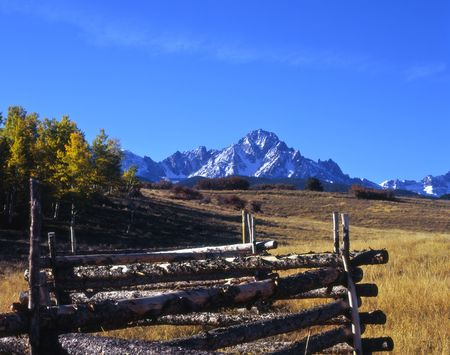 Mt. Sneffels and a log fence in the Uncompahgre National Forest, Colorado.