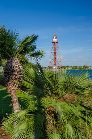 Palm trees in front of Lake Sumter Lighthouse in The Villages, Florida.