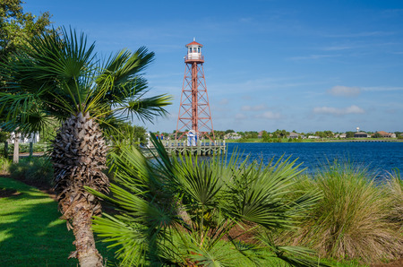 Lake Sumter Lighthouse and palms in The Villages, Florida.