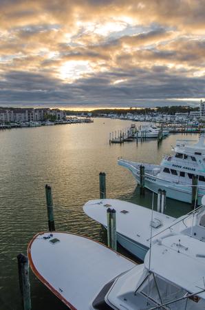 Sunset over boats at Rudee Inlet Marina in Virginia Beach, Virginia