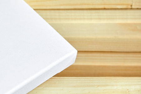 White cotton canvas. Wooden stretchers in the background. Selective focus Foto de archivo